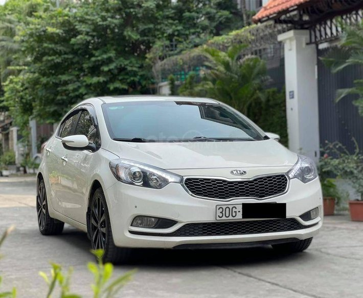 Cần bán lại xe Kia K3 2014, màu trắng, số tự động1
