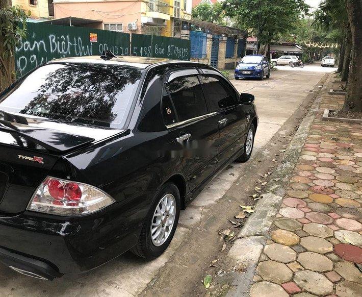 Bán xe Mitsubishi Lancer 2004, màu đen số tự động, 189tr3