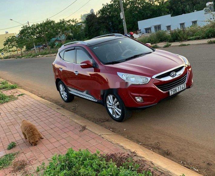 Cần bán xe Hyundai Tucson sản xuất năm 2010, màu đỏ, xe nhập4