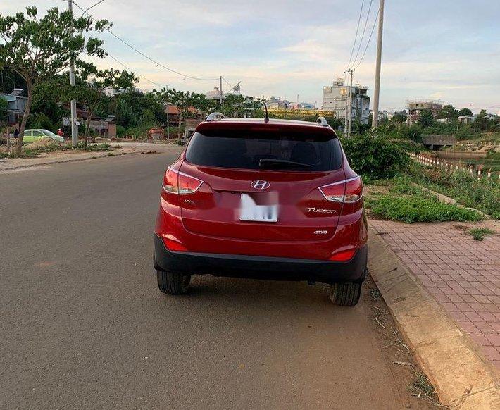 Cần bán xe Hyundai Tucson sản xuất năm 2010, màu đỏ, xe nhập1