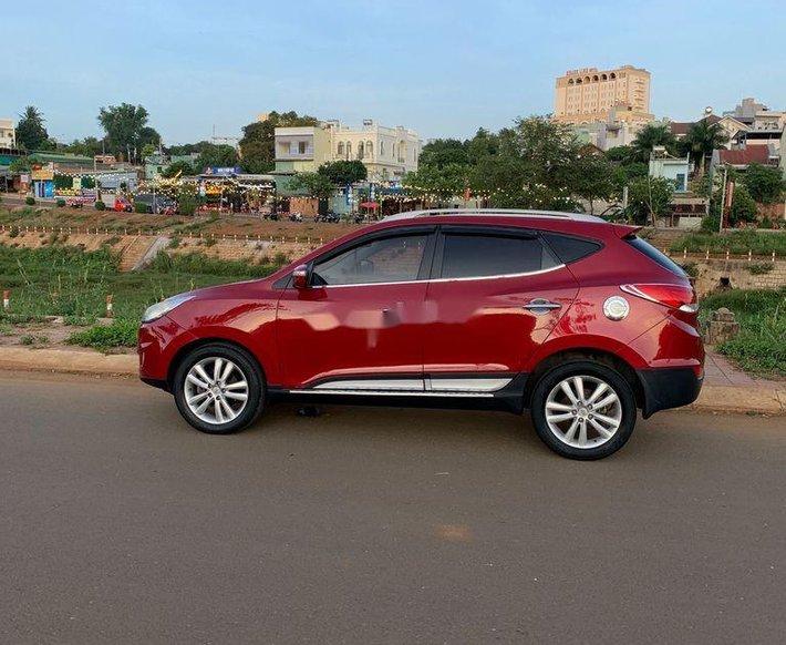 Cần bán xe Hyundai Tucson sản xuất năm 2010, màu đỏ, xe nhập3