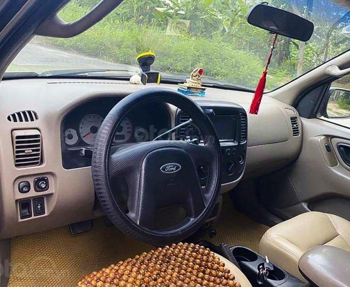Bán ô tô Ford Escape năm 2002, màu vàng còn mới, giá 125tr4