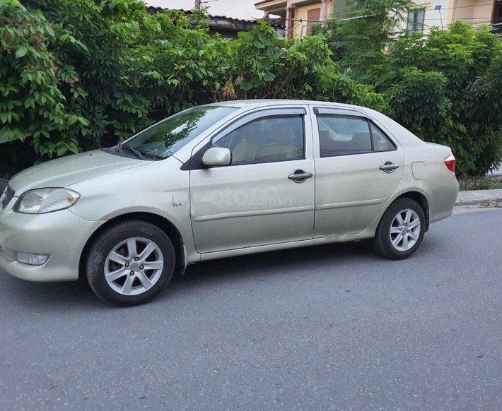 Bán Toyota Vios 1.5G 2003, màu vàng cát0