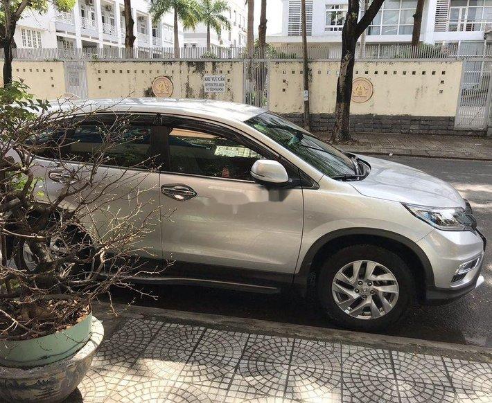 Cần bán Honda CR V năm 2015, màu bạc còn mới, giá tốt0