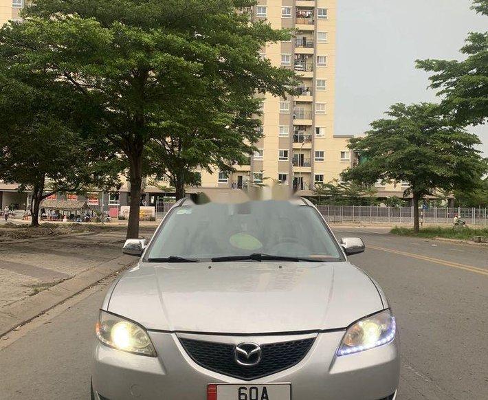 Cần bán Mazda 3 AT đời 2004, màu ghi vàng số tự động0