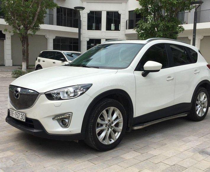 Bán Mazda CX 5 năm sản xuất 2013, màu trắng, giá 583tr0