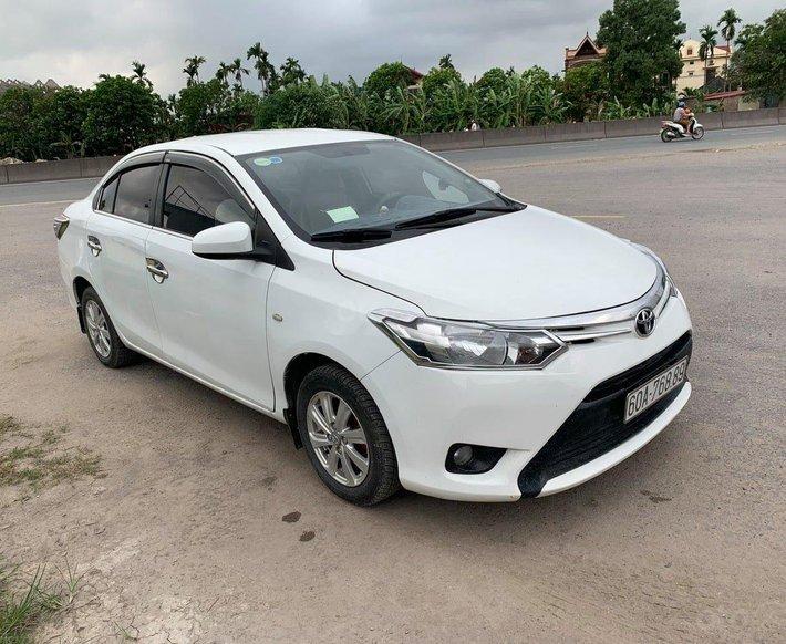 Cần bán Toyota Vios 1.3MT đời 2014, màu trắng0