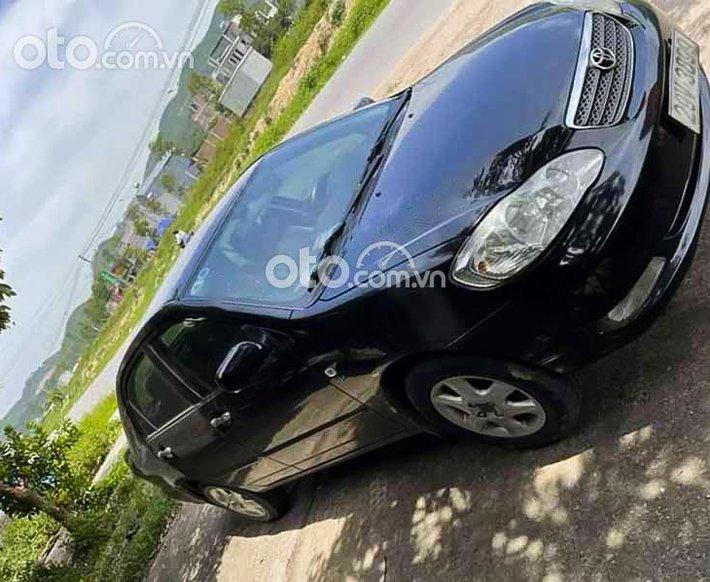 Bán Toyota Corolla Altis 1.8G MT sản xuất năm 2004, màu đen còn mới giá cạnh tranh0