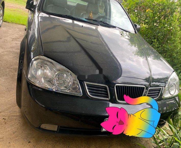 Bán Daewoo Lacetti đời 2004, màu đen, xe nhập, giá 110tr0