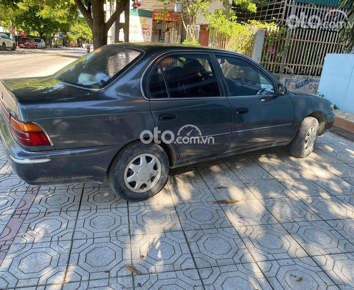 Cần bán Toyota Corolla 1997 màu nâu, 80 triệu0
