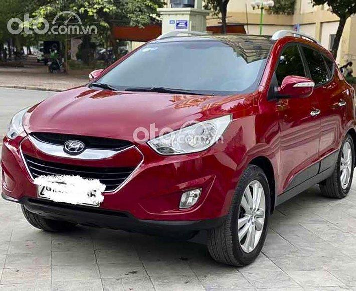 Cần bán gấp Hyundai Tucson 2.0l 4x4 đời 2012, màu đỏ, nhập khẩu  0