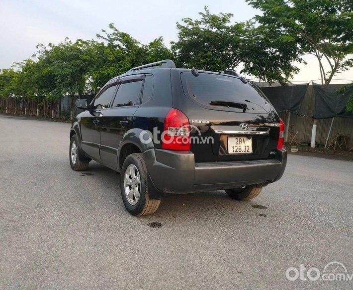 Cần bán xe Hyundai Tucson năm 2009, màu đen, nhập khẩu số tự động0