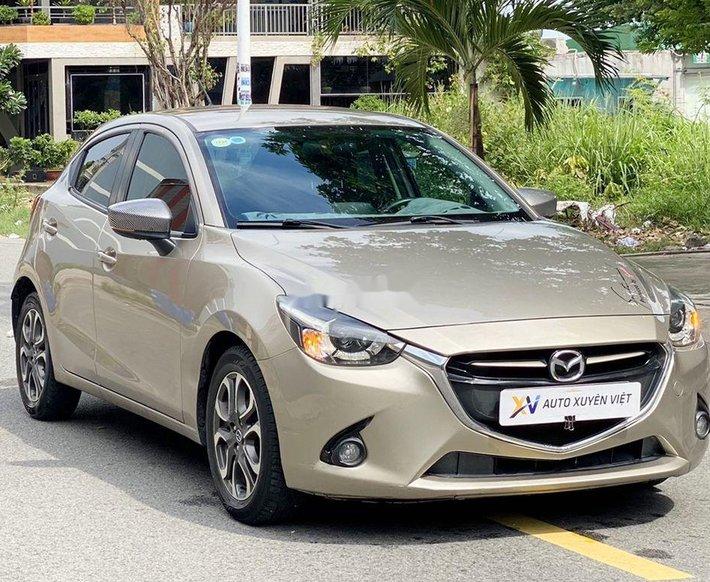 Cần bán lại xe Mazda 2 năm 2015, màu vàng chính chủ, 378tr0
