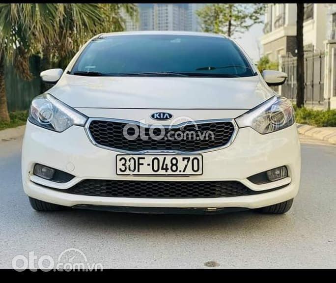 Cần bán Kia K3 đời 2015, màu trắng số sàn, giá chỉ 390 triệu0
