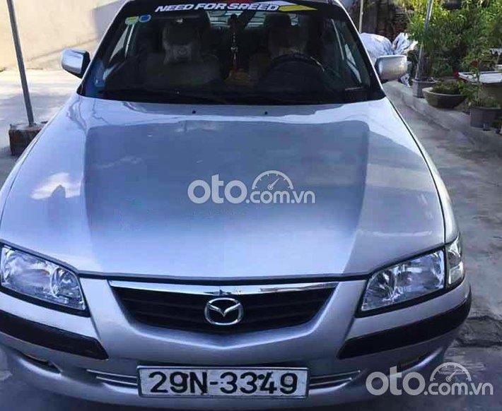 Bán ô tô Mazda 626 2.0 MT năm 2001, màu bạc còn mới0