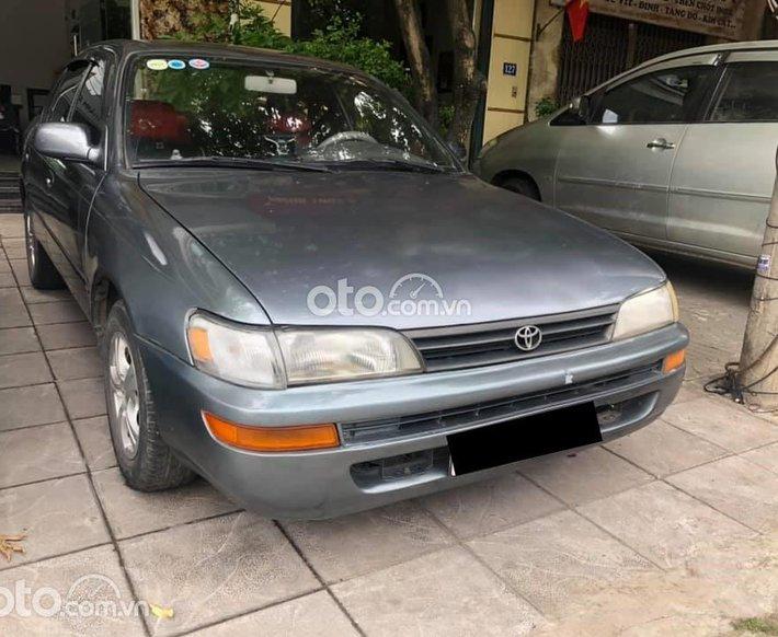 Cần bán gấp Toyota Corolla 1997, màu đen, nhập khẩu nguyên chiếc, giá 75tr0