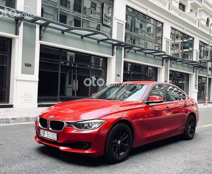 Bán BMW 320i sản xuất 2014, màu đỏ chính chủ, 775tr0