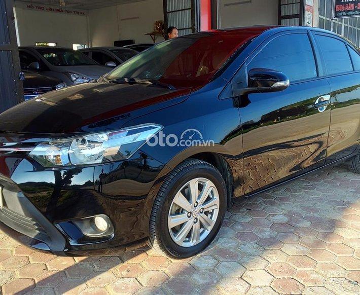 Cần bán gấp Toyota Vios E MT sản xuất năm 2015, màu đen số sàn0