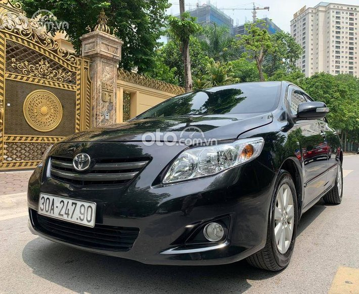 Cần bán lại xe Toyota Corolla Altis đời 2009, màu đen0