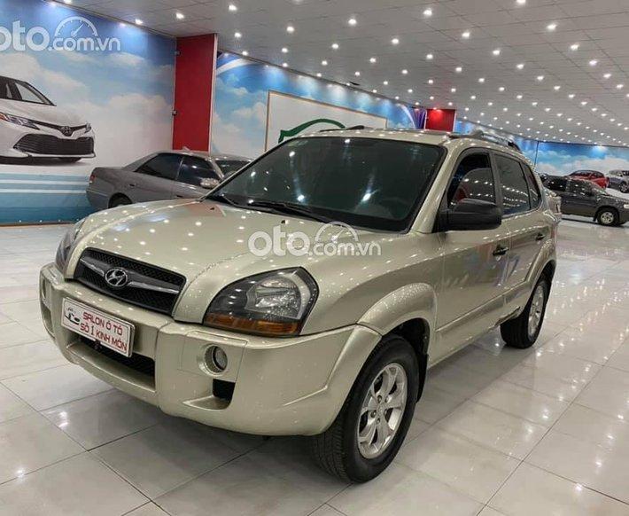 Bán Hyundai Tucson 2009 nhập khẩu Hàn Quốc màu vàng cát0