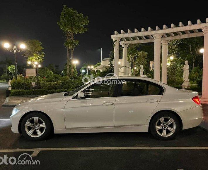 Bán BMW 320i SX năm 2014, màu trắng giá 790tr0