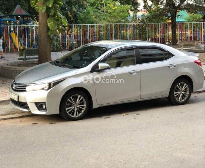 Bán Toyota Corolla Altis sản xuất 2015, màu bạc còn mới giá cạnh tranh0
