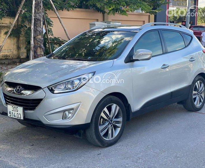 Cần bán lại xe Hyundai Tucson năm sản xuất 2013, màu bạc, nhập khẩu nguyên chiếc giá cạnh tranh0
