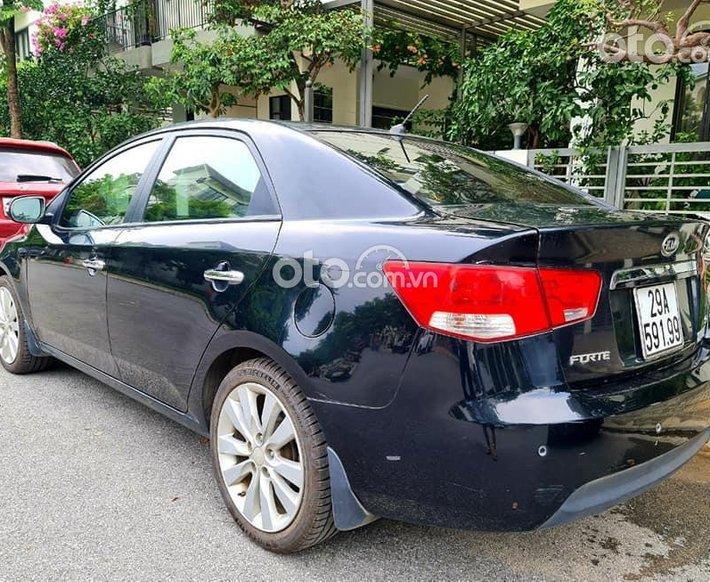 Cần bán Kia Forte sản xuất 2010, màu đen, giá tốt0