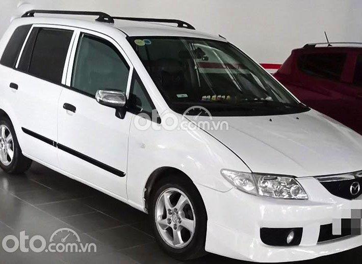 Bán ô tô Mazda Premacy sản xuất năm 2002, màu trắng còn mới0