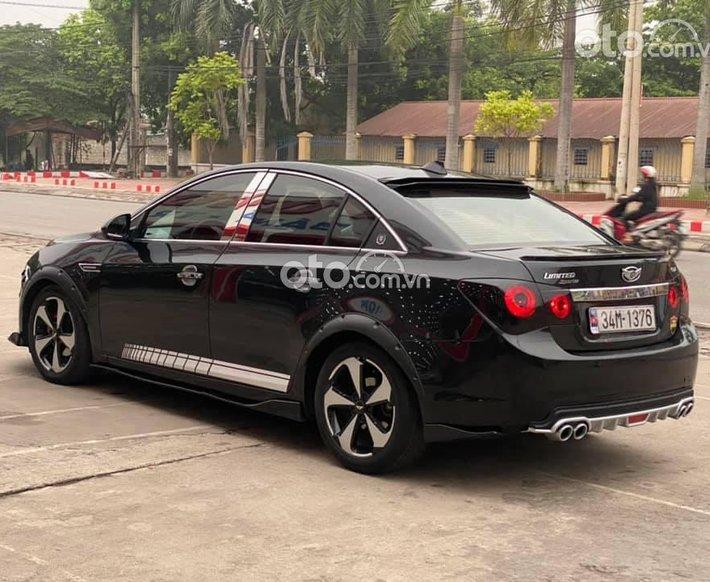 Cần bán Daewoo Lacetti CDX 2009, màu đen số tự động0