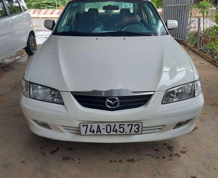 Cần bán Mazda 626 đời 2002, màu trắng còn mới0