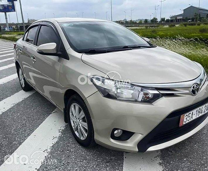 Bán Toyota Vios 1.5E năm 2018, màu ghi vàng 0
