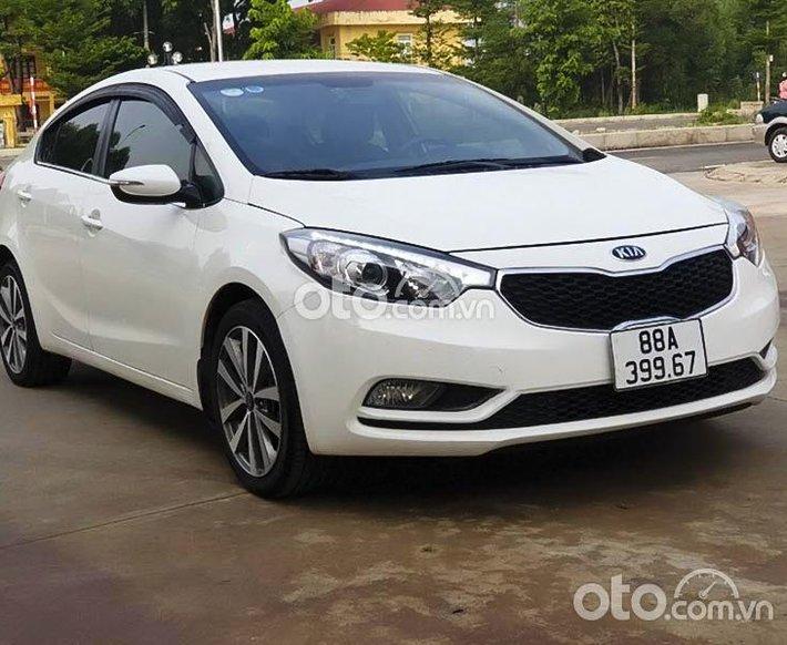 Cần bán xe Kia K3 1.6 AT đời 2015, màu trắng số tự động0