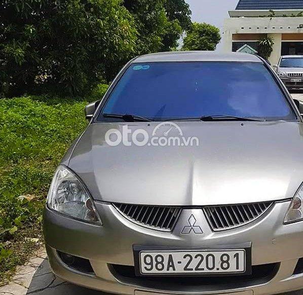 Bán ô tô Mitsubishi Lancer Gala GLX 1.6AT 2005, màu vàng 0