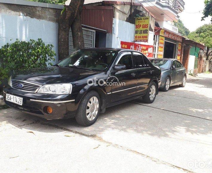 Cần bán lại xe Ford Laser sản xuất năm 2004, màu đen còn mới0