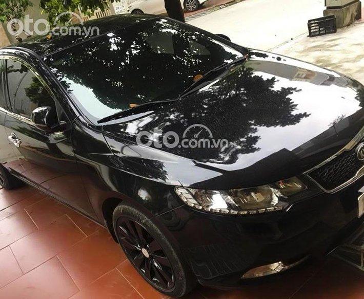 Bán xe Kia Forte 2012, màu đen còn mới giá cạnh tranh0