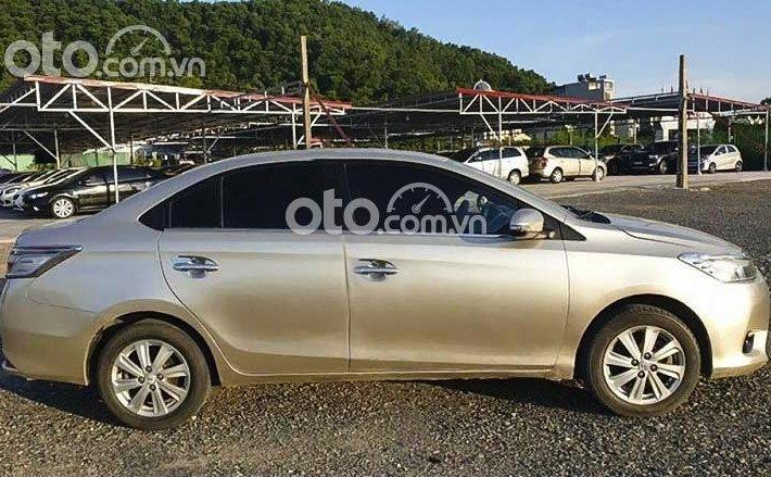 Cần bán lại xe Toyota Vios E sản xuất 2016, màu vàng cát, giá 333tr0