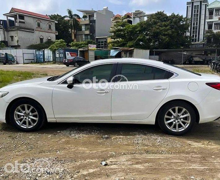 Cần bán Mazda 6 2.0 AT năm 2016, màu trắng còn mới, giá 535tr0