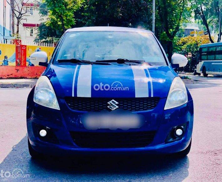 Cần bán lại xe Suzuki Swift năm 2014, màu xanh lam0