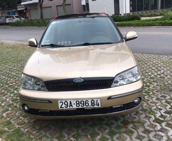Cần bán xe Ford Laser 2002, màu vàng0