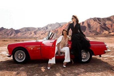 Người mẫu Minh Triệu và Hoa hậu Kỳ Duyên khoe sắc bên Datsun 1600 cổ điển.